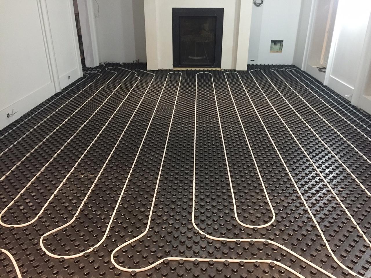 Installation de plancher chauffant à Les Côteaux - Plomberie M-G SERVICE inc. à Les Côteaux